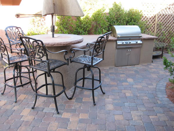 outdoor kitchen and round table top with umbrella