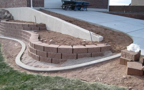 using landscaping block to build a landscape retention wall