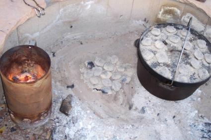 dutch oven cooking in fire pit