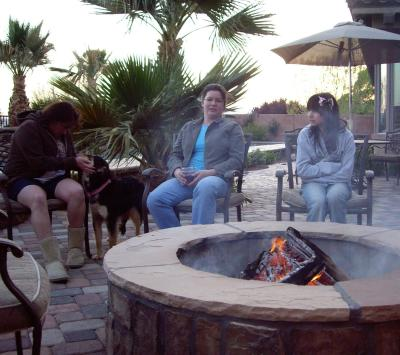 friends hangin out by the fire