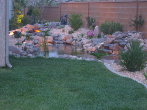 Scape ideal landscaping with boulders and rocks - Cheap pond ideas ...