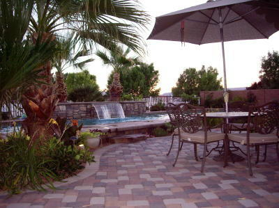 backyard patio with pavers and pool