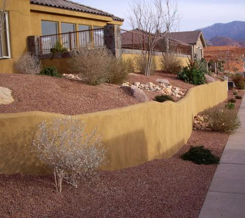 curved stucco retention wall