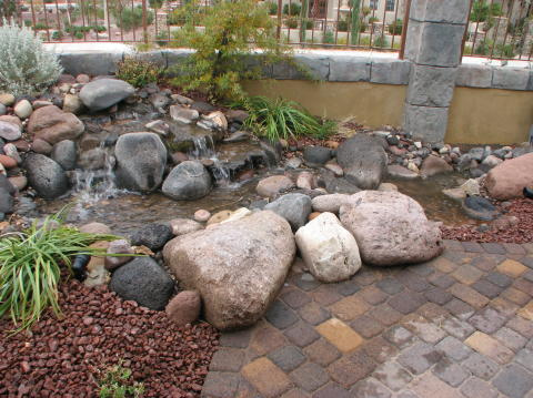 pondless water feature with vault under patio