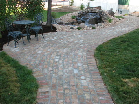real brick walkway and side patio
