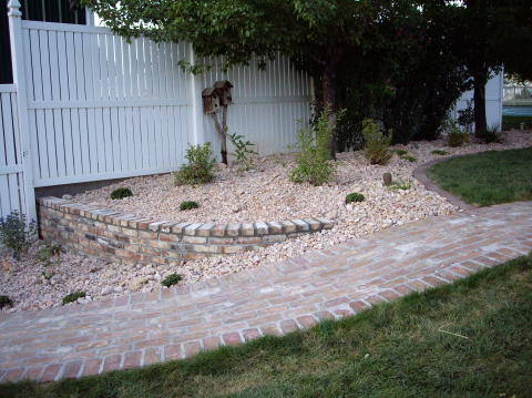 small retention wall with a brick finish